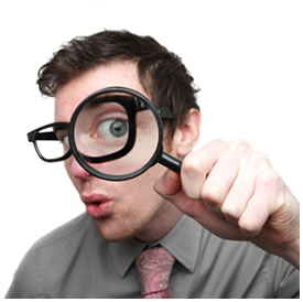 man magnifying glass